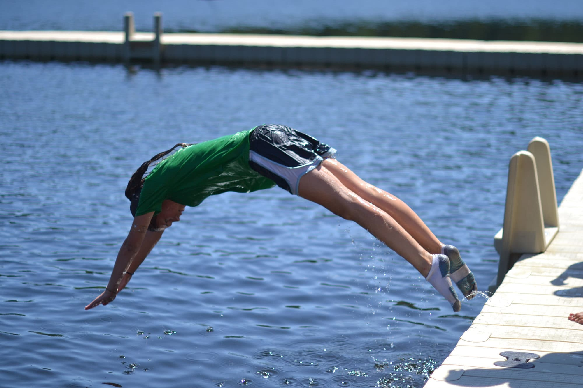 girl diving into water