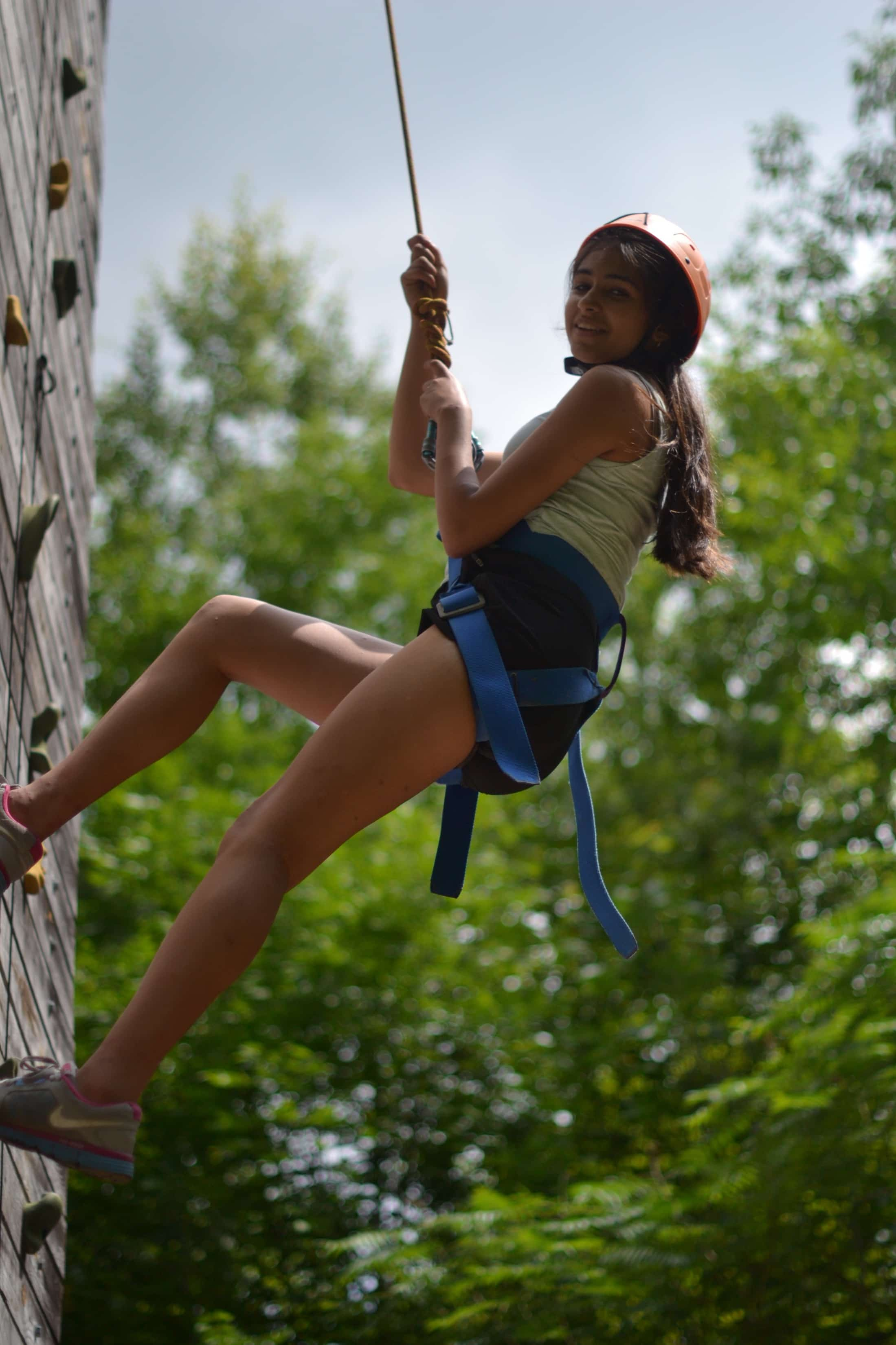 girl ascending climbing wall